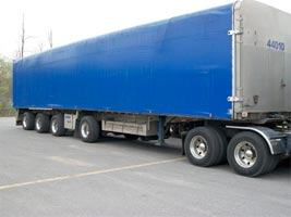 4 axle SPIF with sliding tarp system and Super Single Tires